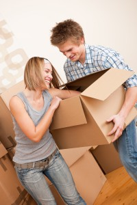 1606900-new-house-young-couple-moving-box-unpacking